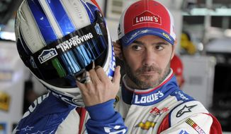 Jimmie Johnson prepares before practice for Sunday's NASCAR Sprint Cup series Coca-Cola 600 auto race at Charlotte Motor Speedway in Concord, N.C., Thursday, May 22, 2014. (AP Photo/Mike McCarn)