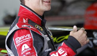 Jeff Gordon talks to crew members before practice for Sunday's NASCAR Sprint Cup series Coca-Cola 600 auto race at Charlotte Motor Speedway in Concord, N.C., Thursday, May 22, 2014. (AP Photo/Terry Renna)