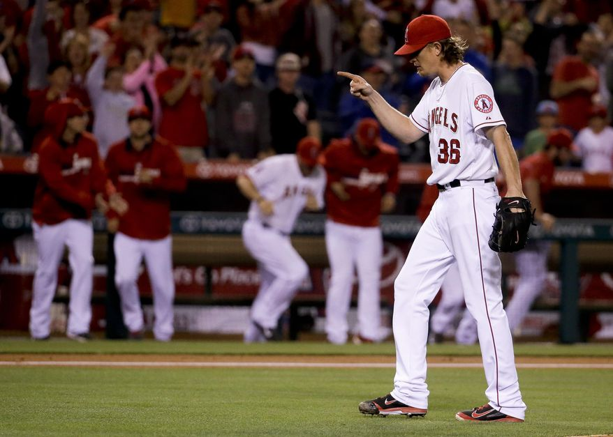 Los Angeles Angels starting pitcher Jered Weaver celebrates their 2-1 win against the Houston Astros during a baseball game in Anaheim, Calif., Wednesday, May 21, 2014. (AP Photo/Chris Carlson)