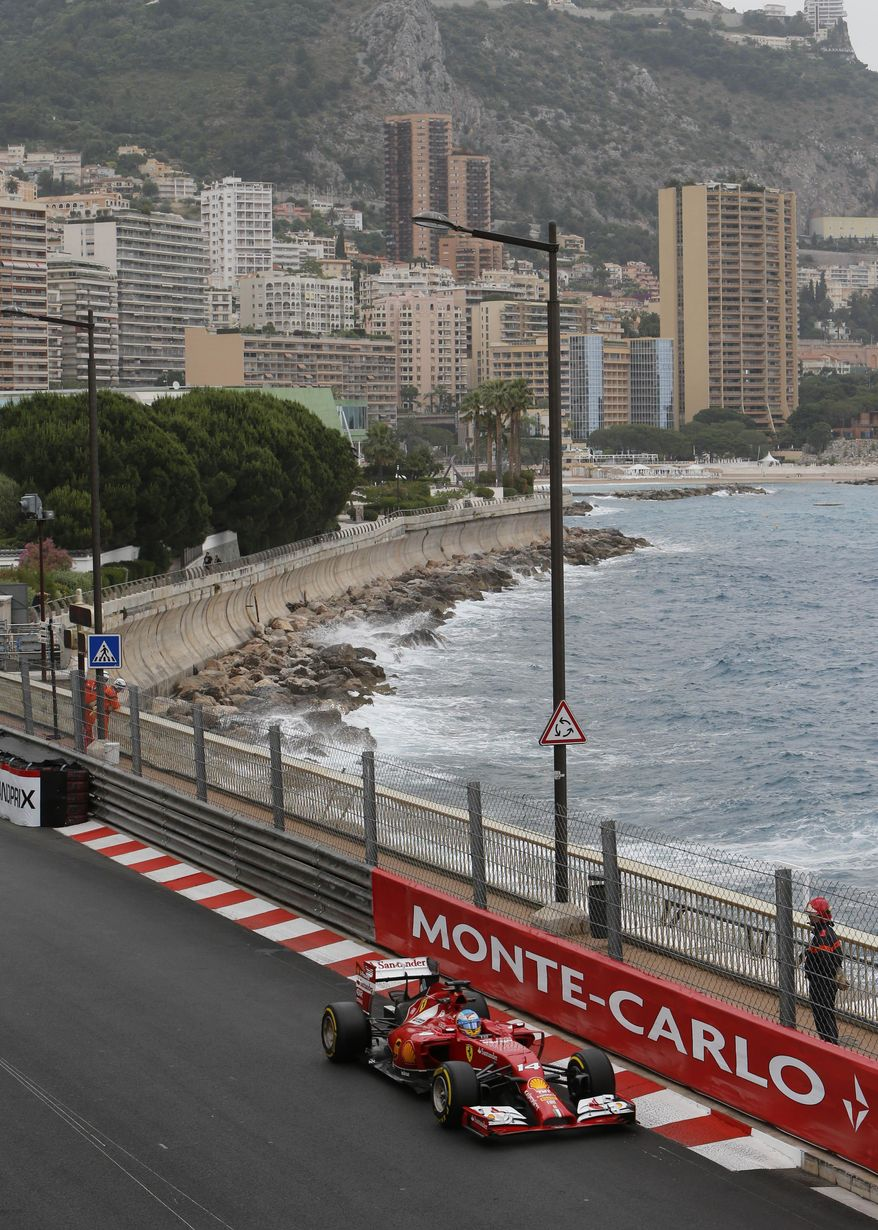 Ferrari driver Fernando Alonso of Spain steers his car during the first free practice at the Monaco racetrack, in Monaco, Thursday, May 22, 2013. The  Monaco Formula One Grand Prix will be held on Sunday. (AP Photo/Claude Paris)