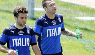 Italy's Antonio Cassano, right, and Giuseppe Rossi attend a training session in Coverciano training complex, in Florence, Italy, Wednesday, May 21, 2014. The Azzurri will train for three days this week then resume full-time preparation next Monday. In Brazil, Italy is in Group D with England, Uruguay and Costa Rica. (AP Photo/Fabrizio Giovannozzi)