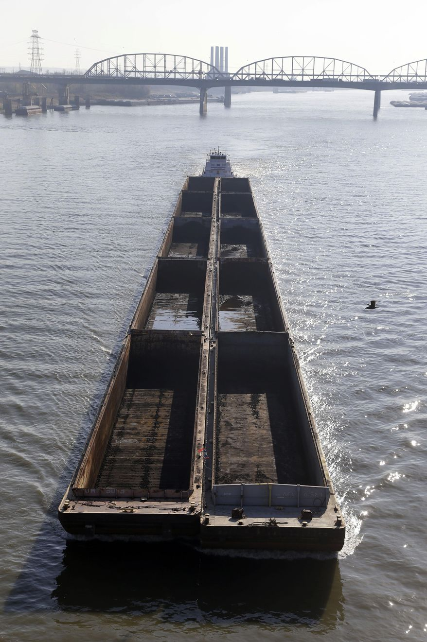 FILE - In this  Nov. 16, 2012 file photo, a barge powers its way up the Mississippi River in St. Louis. Environmental groups have sued the Army Corps of Engineers over the agency's use of man-made structures meant to keep the Mississippi River navigable. The federal lawsuit was filed Thursday, May 22, 2014 in Illinois' East St. Louis. Plaintiffs including the National Wildlife Federation claim the techniques provoke flooding as seen during historic inundations four times in the past two decades. (AP Photo/Jeff Roberson, File)