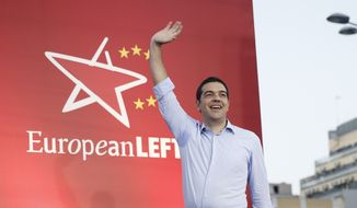 Greece's left-wing opposition leader Alexis Tsipras greets supporters at his party's main election rally in central Athens Thursday, May 22, 2014 Tsipras's anti-bailout Syriza party has extended its lead ahead of weekend voting in local government and European elections, and is vowing to scrap international agreements that rescued the country's economy from bankruptcy but imposed harsh austerity measures. (AP Photo/Petros Giannakouris)