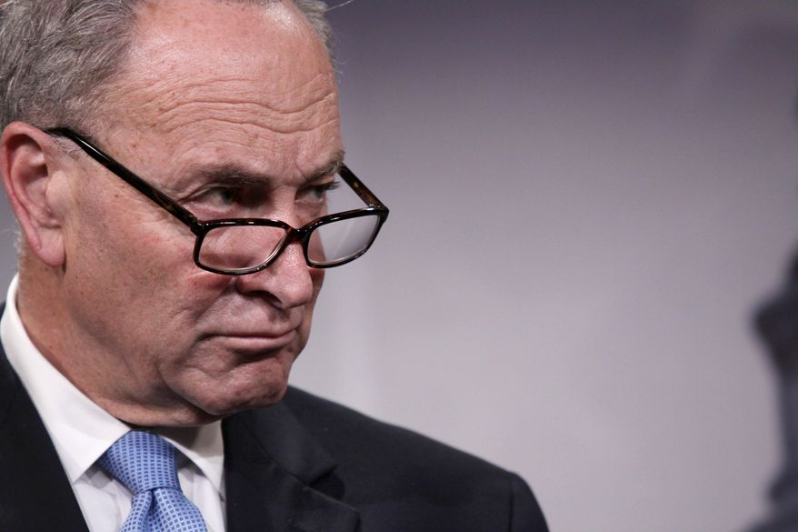 **FILE** Sen. Charles Schumer, New York Democrat, listens during a news conference on Capitol Hill in Washington on May 22, 2014. (Associated Press)