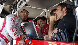 Tony Kanaan, of Brazil, left, talks with former teammate and pace car driver Dario Franchitti, right, of Scotland, on the final day of practice for the Indianapolis 500 IndyCar auto race at the Indianapolis Motor Speedway in Indianapolis, Friday, May 23, 2014. The 98th running of the Indianapolis 500 is Sunday. (AP Photo/Tom Strattman)