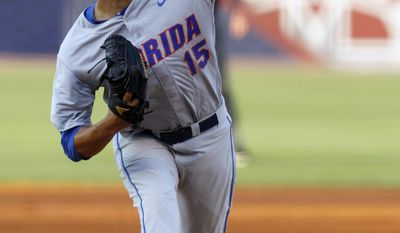 Florida's Danny Young pitches against Mississippi State during the first inning at the Southeastern Conference NCAA college baseball tournament Friday, May 23, 2014, in Hoover, Ala. (AP Photo/Butch Dill)
