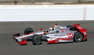 Tony Kanaan, of Brazil, heads into the first turn on the final day of practice for the Indianapolis 500 IndyCar auto race at the Indianapolis Motor Speedway in Indianapolis, Friday, May 23, 2014. The 98th running of the Indianapolis 500 is Sunday. (AP Photo/Tom Strattman)