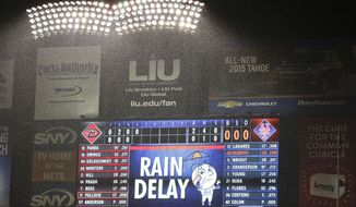 The lights of Citi Field illuminate the pouring rain during a rain delay of a baseball game between the Arizona Diamondbacks and the New York Mets, Friday, May 23, 2014, in New York. (AP Photo/Julie Jacobson)