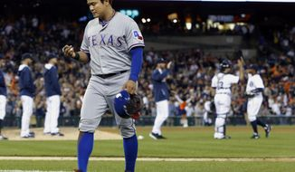 Texas Rangers' Shin Soo-Choo walks off the diamond after a 7-2 loss to the Detroit Tigers in a baseball game Friday, May 23, 2014, in Detroit. (AP Photo/Duane Burleson)