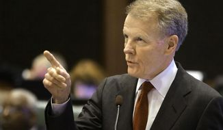Illinois House Speaker Michael Madigan, D-Chicago, speaks to lawmakers on the House floor during session at the state Capitol Friday, May 23, 2014, in Springfield, Ill. (AP Photo/Seth Perlman)