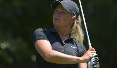 Suzann Pettersen of Norway watches her the shot on the fifth hole during the second round of the Airbus LPGA Classic golf tournament at Magnolia Grove on Friday, May 23, 2014, in Mobile, Ala. (AP Photo/G.M. Andrews)