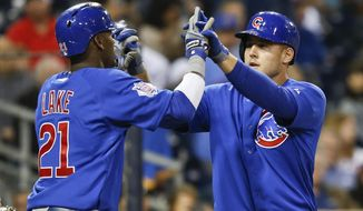 Chicago Cubs' Anthony Rizzo is congratulated by Junior Lake as he crosses home plate with a two run home run against then San Diego Padres in the fourth inning of a baseball game Thursday, May 22, 2014, in San Diego.  (AP Photo/Lenny Ignelzi)