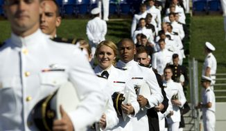 Graduating U.S. Naval Academy Midshipmen in a procession entrance during the United States Naval Academy 2014 Class graduation and commissioning ceremonies at Navy-Marine Corps Stadium in Annapolis, Md., Friday May 23, 2014. (AP Photo/Jose Luis Magana)