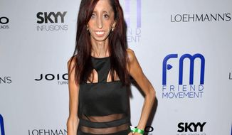 """FILE - This July 1, 2013 file photo shows author and motivational speaker Lizzie Velasquez at the Friend Movement Anti-Bullying Benefit Concert at the El Rey Theatre in Los Angeles. Velasquez, who possesses a rare and unknown syndrome that prevents her from gaining weight, is raising funds on Kickstarter through June 1, 2014, for an anti-bulling documentary, titled, """"The Lizzie Project.""""  (Photo by John Shearer/Invision/AP, File)"""