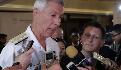 "** FILE ** U.S. Pacific Command's Adm. Samuel J. Locklear III, talks to the media following a session on ""Security Outlook"" in the ongoing World Economic Forum on East Asia Friday, May 23, 2014, at the financial district of Makati city east of Manila, Philippines. (AP Photo/Bullit Marquez)"
