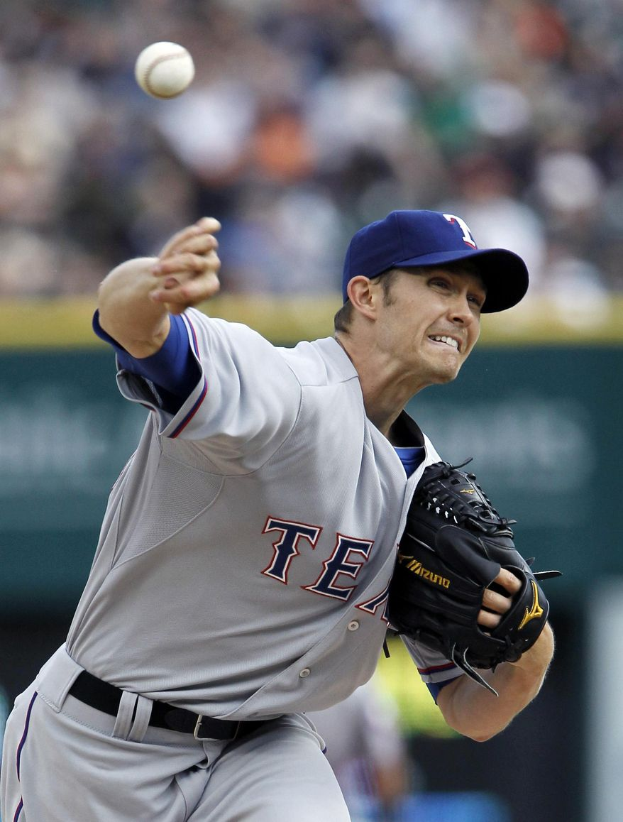 Texas Rangers' Scott Baker pitches against the Detroit Tigers in the first inning of a baseball game Friday, May 23, 2014, in Detroit. (AP Photo/Duane Burleson)