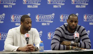 The Miami Heats Dwyane Wade, left, and LeBron James talk with the media after Game 2 of the NBA basketball Eastern Conference finals against the Indiana Pacers in Indianapolis, Tuesday, May 20, 2014. The Heat won 87-83. (AP Photo/AJ Mast)