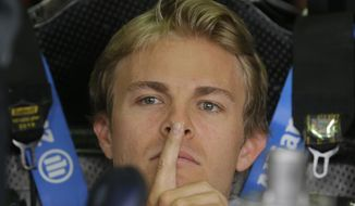 Mercedes driver Nico Rosberg of Germany gesticulates at pits during the second free practice at the Monaco racetrack, in Monaco, Thursday, May 22, 2013. The  Monaco Formula One Grand Prix will be held on Sunday. (AP Photo/Luca Bruno)