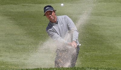 Stephen Ames hits out of a bunker on the 16th fairway during the second round of the 75th Senior PGA Championship golf tournament at Harbor Shores Golf Club in Benton Harbor, Mich., Friday, May 23, 2014. (AP Photo/Paul Sancya)