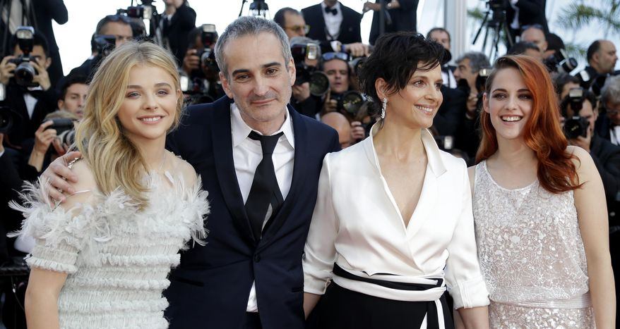 From left, actress Chloe Grace Moretz, director Olivier Assayas, actress Juliette Binoche and actress Kristen Stewart arrive for the screening of Sils Maria at the 67th international film festival, Cannes, southern France, Friday, May 23, 2014. (AP Photo/Thibault Camus)