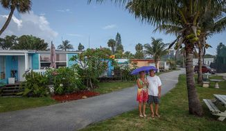 ADVANCED FOR RELEASE MONDAY, MAY 26, 2014 Residents of Suni Sands mobile home park, Debbie and Dave Cooper, in Jupiter, Fla., are worried they may soon lose their homes. Photos from the park on Wednesday, May 14, 2014.  (AP Photo/ The Palm Beach Post, Thomas Cordy)