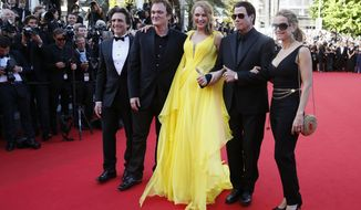 From right, Kelly Preston, John Travolta, Uma Thurman, director Quentin Tarantino and producer Laurence Bender arrive for the screening of Sils Maria at the 67th international film festival, Cannes, southern France, Friday, May 23, 2014. (AP Photo/Alastair Grant)