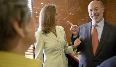 """Pennsylvania Democratic gubernatorial nominee Tom Wolf, right, former state Environmental Protection Secretary Katie McGinty, center, and U.S. Rep. Allyson Schwartz, D-Pa., meet before a meal at the Oregon Diner, Friday, May 23, 2014, in Philadelphia. The group and others gathered in what  U.S. Rep. Bob Brady, D-Pa., billed as a """"unity"""" breakfast with the three candidates, State Treasurer Rob McCord, McGinty, and Schwartz, Wolf defeated in the primary election after the campaign turned particularly nasty in the last six weeks. (AP Photo/Matt Rourke)"""