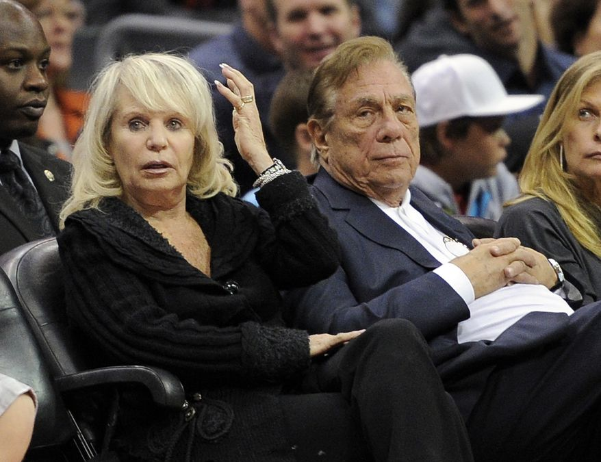 FILE - In this Nov. 12, 2010 file photo, Los Angeles Clippers owner Donald T. Sterling, right, sits with his wife Shelly during the Clippers NBA basketball game against the Detroit Pistons in Los Angeles. Donald Sterling has agreed to surrender his stake of the Clippers to his wife, and she is moving forward with selling the team. A person with knowledge of the negotiations told The Associated Press Friday. May 23, 2014, that the couple made the agreement after weeks of discussion. The individual wasn't authorized to speak publicly about the agreement. (AP Photo/Mark J. Terrill, File)