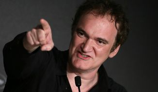 Director Quentin Tarantino speaks during a press conference at the 67th international film festival, Cannes, southern France, Friday, May 23, 2014. (AP Photo/Virginia Mayo)