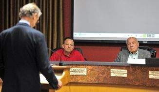 Public Safety Retirement System Board Fire Representative Eric Kriwer and Chairman Marlin Kuykendall listen to the closing arguments of the Ashcraft families lawyer Patrick McGroder Thursday afternoon May 22, 2014 during the second day of the PSRS hearing for Granite Mountain Hotshot Andrew Ashcraft at Prescott City Hall in Prescott Ariz.  (AP Photo/The Daily Courier, Matt Hinshaw)