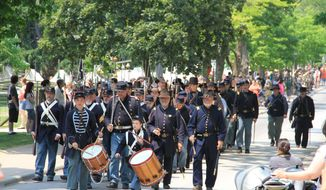 In this May 27, 2012 photo provided by Greenfield Village, a Civil War parade marches in Dearborn, Mich.  Greenfield Village is being transformed this weekend into 1860s America for a series of Civil War commemorative events.  (AP Photo/Greenfield Village)