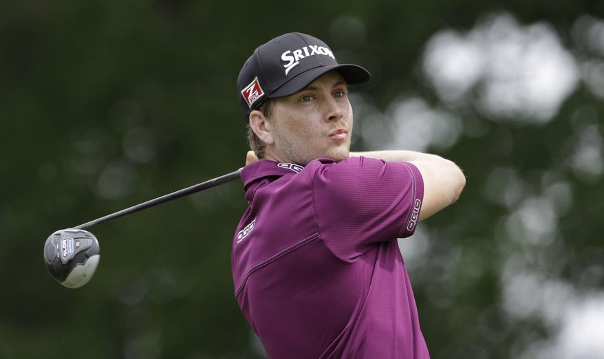 Chris Stroud watches his tee shot on the eighth hole during the second round of the PGA Colonial golf tournament in Fort Worth, Texas, Friday, May 23, 2014.   (AP Photo/LM Otero)
