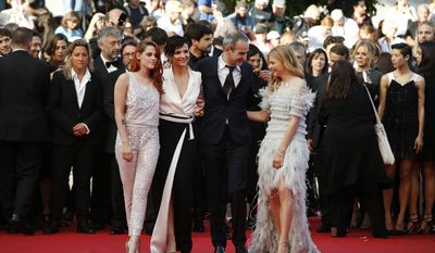 From left, actress Kristen Stewart, actress Juliette Binoche, director Olivier Assayas and actress Chloe Grace Moretz arrive for the screening of Sils Maria at the 67th international film festival, Cannes, southern France, Friday, May 23, 2014. (AP Photo/Alastair Grant)