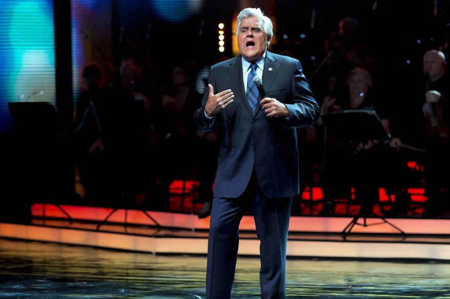 In this Thursday, May 22, 2014 photo, TV comedian Jay Leno hosts the Genesis Prize awards in Jerusalem. The 1-million dollar prize seeks to recognize individuals who have attained excellence and international renown in their chosen professional fields, and whose actions, in addition to their achievements, embody the character of the Jewish people through commitment to Jewish values, the Jewish community and/or to the State of Israel. Former New York City Mayor Michael Bloomberg was presented with the award on Thursday. (AP photo/Jim Hollander, Pool)