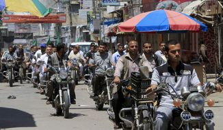 Palestinian Hamas supporters ride their motorcycles during a rally to support Palestinian prisoners on hunger strike at Israeli jails, in Khan Younis, in the southern Gaza Strip on Friday, May 23, 2014. (AP Photo/Adel Hana)