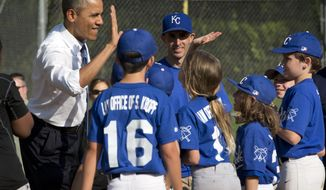 In this May 19, 2014, photo, President Barack Obama greets players as he makes an unannounced stop to surprise members of the Northwest little league baseball teams at Friendship Park in Washington.  Obama seems to have caught a bad case of cabin fever. Since taking office, Obama has periodically grumbled about the claustrophobia that sets in when his every move is surrounded by intense security, rendering it nearly impossible to enjoy the simple pleasures that private citizens take for granted. But in recent days, the president has made more of a point to get out.  (AP Photo/Pablo Martinez Monsivais)