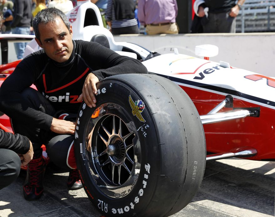 In this photo taken on May 18, 2014, Juan Pablo Montoya, of Colombia, sits next to his car as he waits for his turn to qualify during qualifications for Indianapolis 500 IndyCar auto race at the Indianapolis Motor Speedway in Indianapolis. Montoya needed four races to get comfortable again in an Indy car. His feel has returned just in time for the Indianapolis 500, the race he won in 2000. (AP Photo/Tom Strattman)