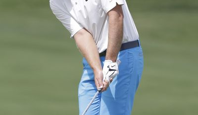 Kevin Chappell hits onto the 18th hole during the third round of the PGA Colonial golf tournament in Fort Worth, Texas, Saturday, May 24, 2014. (AP Photo/LM Otero)