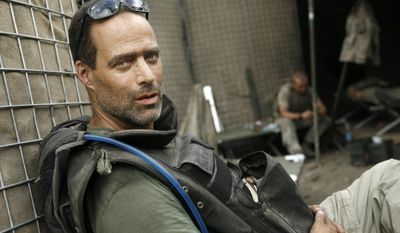 """This 2008 photo released by Outpost Films & Saboteur Media shows filmmaker and journalist Sebastian Junger, photographed by Tim Hetherington, while they were embedded with U.S. troops in OP Restrepo, in Afghanistan. From May 2007 to July 2008, Junger and his colleague  Hetherington chronicled the deployment of the platoon in the deadliest valley in Afghanistan, and the experiences they captured became """"Restrepo."""" Junger's new documentary film, """"Korengal,"""" continues where his prior film, """"Restrepo,"""" left off, constructed by the director from unseen footage, releasing first in New York on May 30, 2014, and nationwide soon after.  (AP Photo/Outpost Films and Saboteur Media, Tim Hetherington)"""