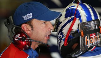Crew chief Chad Knause, left, talks with Jimmie Johnson, right, during practice for Sunday's NASCAR Sprint Cup series Coca-Cola 600 auto race at Charlotte Motor Speedway in Concord, N.C., Saturday, May 24, 2014. (AP Photo/Chris Keane)