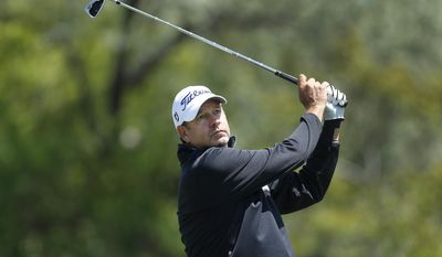 Bart Bryant hits a tee shot on the fourth hole during the third round of the 75th Senior PGA Championship golf tournament at Harbor Shores Golf Club in Benton Harbor, Mich., Saturday, May 24, 2014. (AP Photo/Paul Sancya)