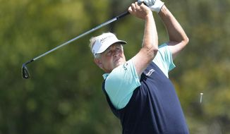 Colin Montgomerie tees off on the fourth hole during the third round of the 75th Senior PGA Championship golf tournament at Harbor Shores Golf Club in Benton Harbor, Mich., Saturday, May 24, 2014. (AP Photo/Paul Sancya)