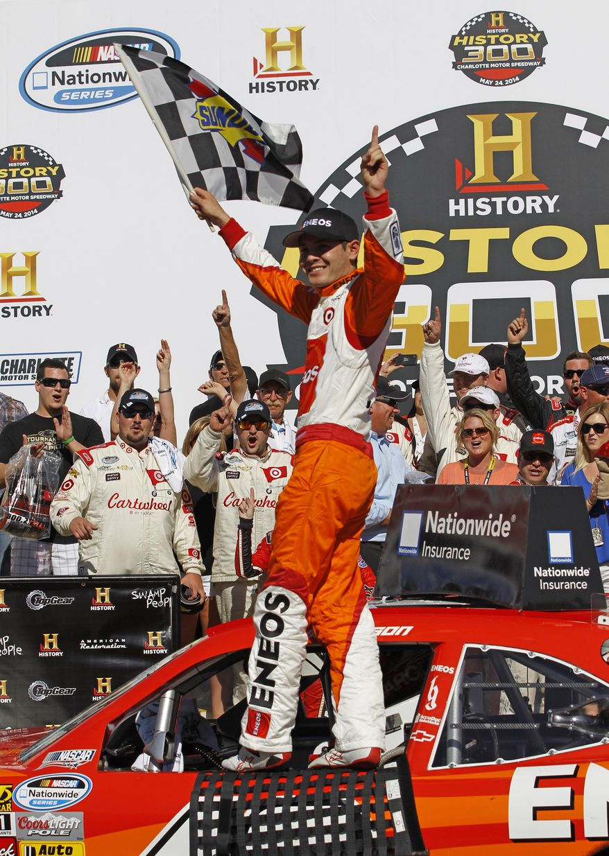 Kyle Larson poses for photos in Victory Lane after winning the NASCAR Nationwide series History 300 auto race at Charlotte Motor Speedway in Concord, N.C., Saturday, May 24, 2014. (AP Photo/Terry Renna)