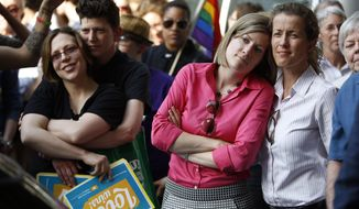 FILE - In this May 20, 2014 file photo, from right, Viola Vetterm and her wife Kate Potalivo, and Amber Orion and her partner, Joy Payton listen to a speaker during a rally at City Hall in Philadelphia. Pennsylvania's ban on gay marriage was overturned by U.S. District Judge John E. Jones III on May 20. (AP Photo/Matt Slocum, File)