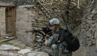 "This image released by Outpost Films & Saboteur Media shows 1st ID Soldier on Relief in Place/Transfer of Authority (RIP/TOA) patrol in Afghanistan in the documentary film, ""Korengal,"" by director Sebastian Junger. The movie is in limited U.S. release on May 30, 2014, and goes nationwide soon after. (AP Photo/Outpost Films and Saboteur Media)"
