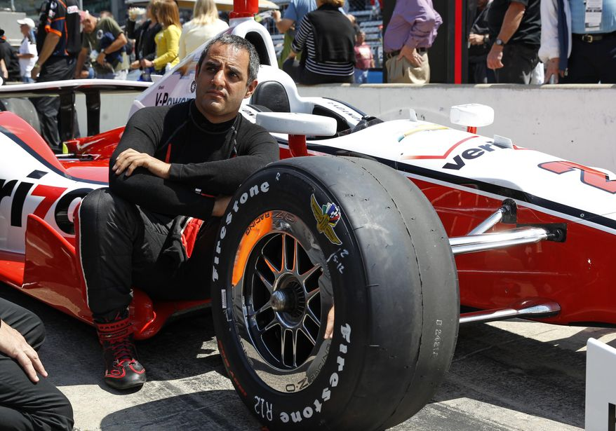Juan Pablo Montoya, of Colombia, waits for his turn to drive during qualifications for the Indianapolis 500 IndyCar auto race at the Indianapolis Motor Speedway in Indianapolis, Sunday, May 18, 2014. (AP Photo/Tom Strattman)