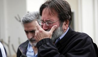 Richard Martinez who says his son Christopher Martinez was killed in Friday night's mass shooting that took place in Isla Vista, Calif., breaks down as he talks to media outside the Santa Barbara County Sheriff's Headquarters on Saturday, May 24, 2014, in Santa Barbara, Calif. (AP Photo/Jae C. Hong)