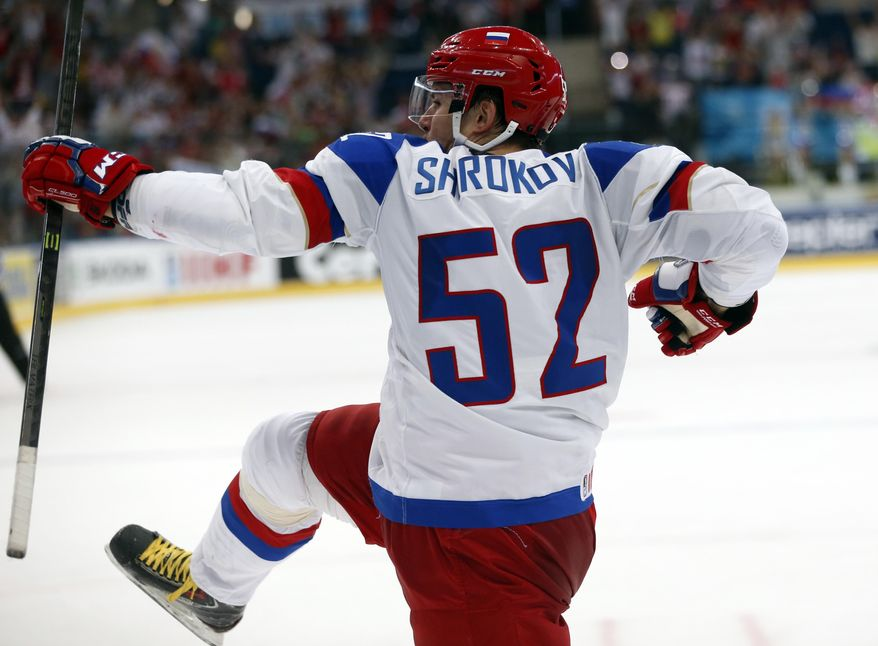 Russia forward Sergei Shirokov, celebrates his goal during a semifinal match between Russia and Sweden at the Ice Hockey World Championship in Minsk, Belarus, Saturday, May 24, 2014. (AP Photo/Darko Bandic)
