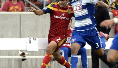 Real Salt Lake defender Tony Beltran (2) goes for the ball along with FC Dallas defender Moises Hernandez (3) during an MLS soccer game on Saturday, May 24, 2014, in Sandy, Utah. (AP Photo/The Salt Lake Tribune, Rick Egan) LOCAL TV OUT; MAGAZINES OUT; DESERET NEWS OUT