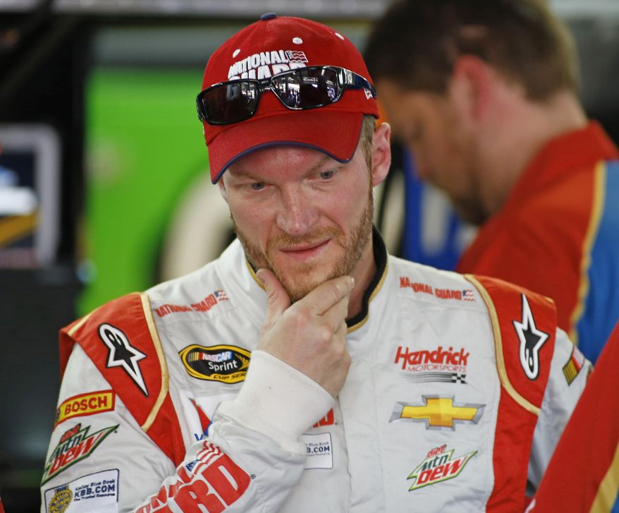 Dale Earnhardt Jr. looks over his car during practice for Sunday's NASCAR Sprint Cup series Coca-Cola 600 auto race at Charlotte Motor Speedway in Concord, N.C., Saturday, May 24, 2014. (AP Photo/Chris Keane)